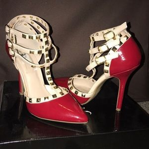 Red studded T-strap pumps